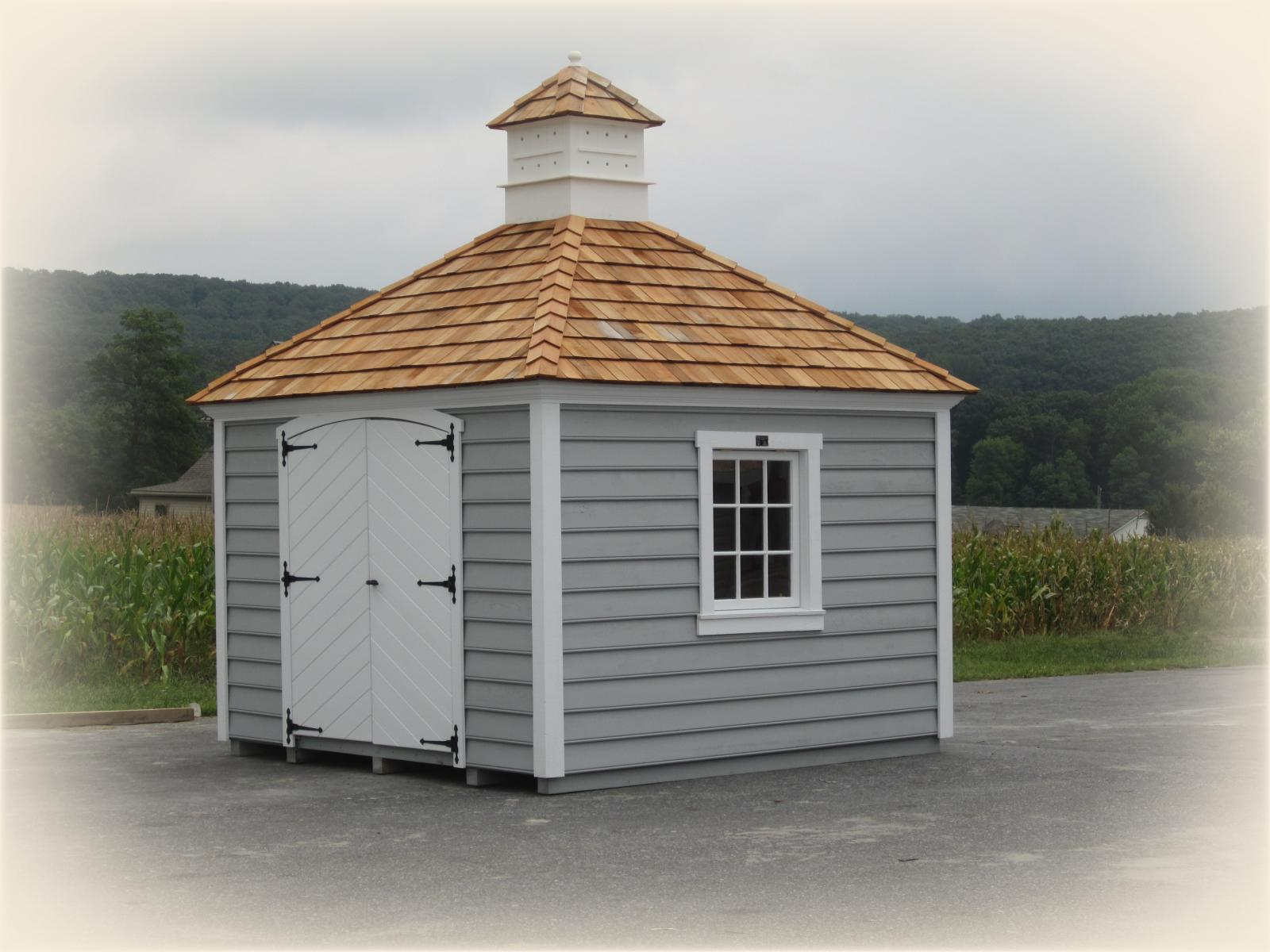 hip roof sheds photos homestead structures 10 x 10 laurel hip shed w crown molding facia cypress beaded siding