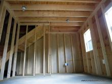 Unfinished interior of 14' x 24' Liberty Dutch Barn with cedar shake siding
