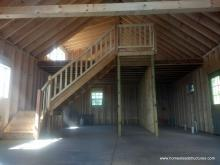 Interior of 22' x 44' custom Liberty 2-story shed with timber frame overhang