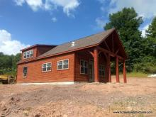 22' x 44' custom Liberty 2-story shed with timber frame overhang