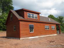 22' x 44' custom Liberty 2-story shed with timber frame overhang in NY