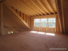 Interior dormer of 22' x 44' custom Liberty 2-story shed with timber frame overhang in NY