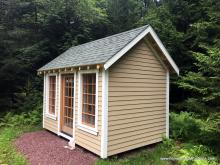8x14 custom garden shed with wood stained window panes and door