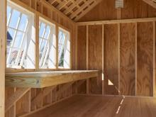 Premier Garden Shed interior with potting bench and skylight