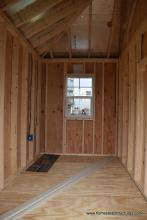 Unfinished interior of 12x14 Siesta with 1 window
