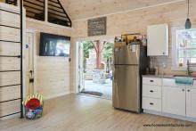 Finished Interior of 16x24 Custom Liberty Pool House wtih kitchenette & bathroom
