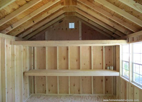 Interior of 10' x 14' Laure a-frame shed with potting bench
