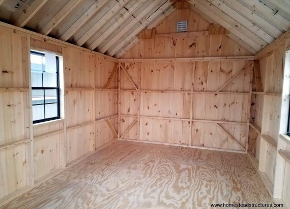 Interior of 10 x 16 Classic A-Frame Shed with board & batten siding in Mushroom stain
