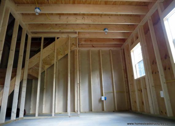 Unfinished interior of 14' x 24' Liberty Dutch Barn with cedar shake siding