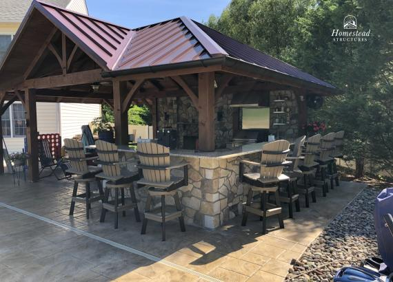 16' x 26' Timber Frame Pavilion with stone fireplace, bar & privacy wall