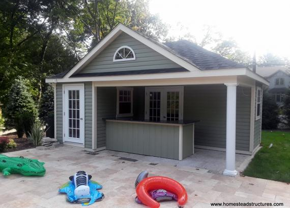 14' x 20' Wellington with hip roof and vinyl siding and porch bar