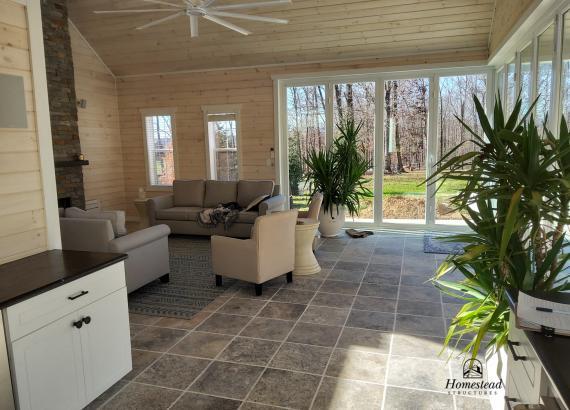 Finished interior Lounge & Fireplace of 30' x 32' Custom Pool House with Origin Bi-Fold Doors