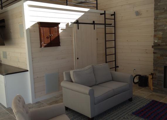 Finished interior Loft & Lounge of 30' x 32' Custom Pool House with Origin Bi-Fold Doors