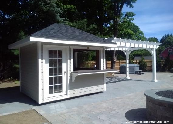8 x 26 Hip roof pool shed & concession stand with vinyl pergola