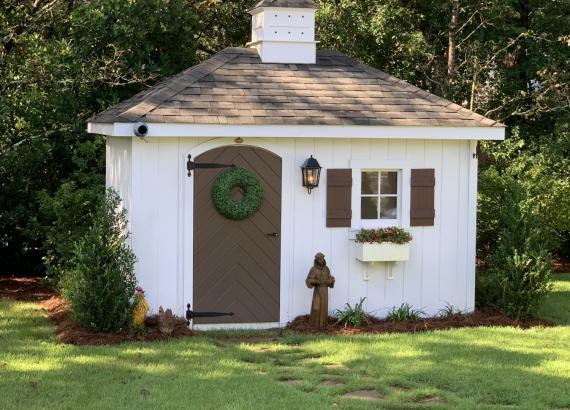 8' x 12' Classic Shed with hip roof, flower box, birdhouse cupola & porch light