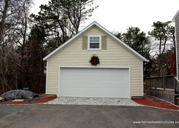 2 story 2-car garage with vinyl siding