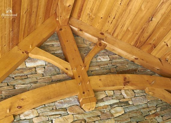 Timber Frame Rafters & Gable with Stone Wall